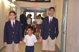 8th Graders Walked Kindergarten Students Into the First Chapel
